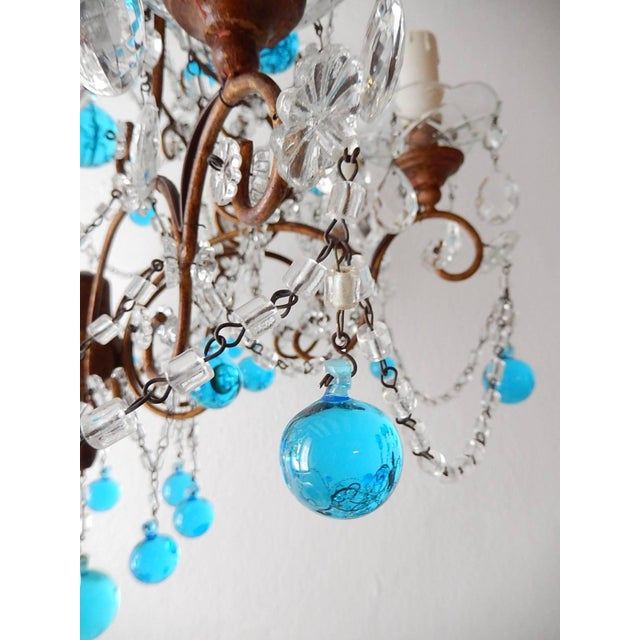 Housing eight lights, sitting in crystal bobeches dripping with vintage crystals. Rewired and ready to hang. Giltwood top,...