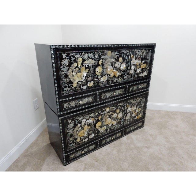 Gorgeous Hand made Chinese Intricate Mother of Pearl Cabinets. This is a high quality Piece of Chinese Furniture . The...