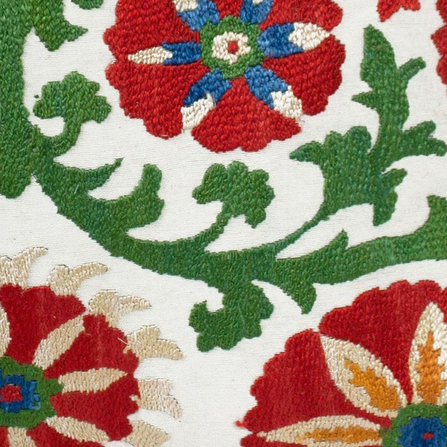 """Fabric: Embroidered front and linen back Dimensions: 17""""W x 17""""H Insert: Feather and down Part of the exclusive CLOTH &..."""