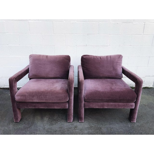 Phenomenal pair of amethyst/plum colored parsons armchairs in the style of Milo Baughman. A very rare find; two in great...