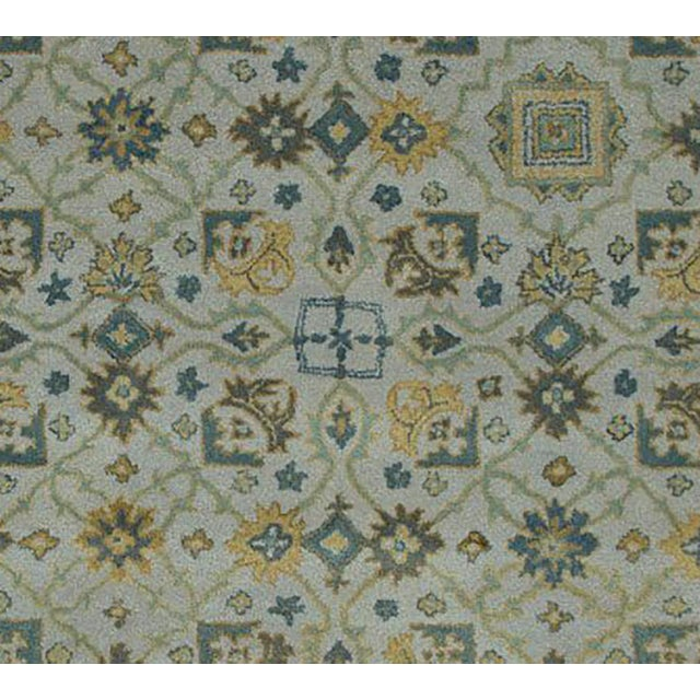 With a regal design, this rug will make an elegant statement piece in a traditional or transional home. Ethically handmade...