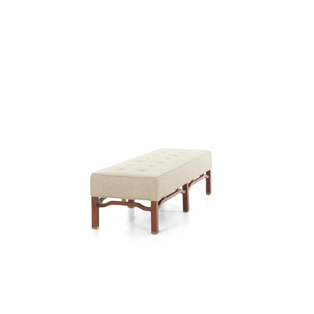 Harvey Probber long bench, mahogany base with brass feet, reupholstered with great plains cotton-linen blend.