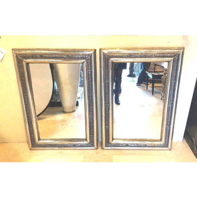 A stunning pair of handcrafted Hollywood Regency style Moroccan mirrors. The pair feature a refined filigree design ornate...