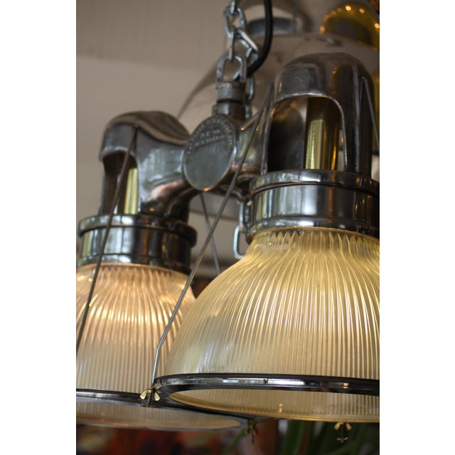 Steel, brass & prismatic, and ribbed glass industrial double light fixture, produced by Holophane in the 40s. Original...
