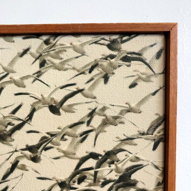 Vintage 1970s framed sepia photograph of flying geese printed on canvas. The frame is a minimal mid-century wooden frame...