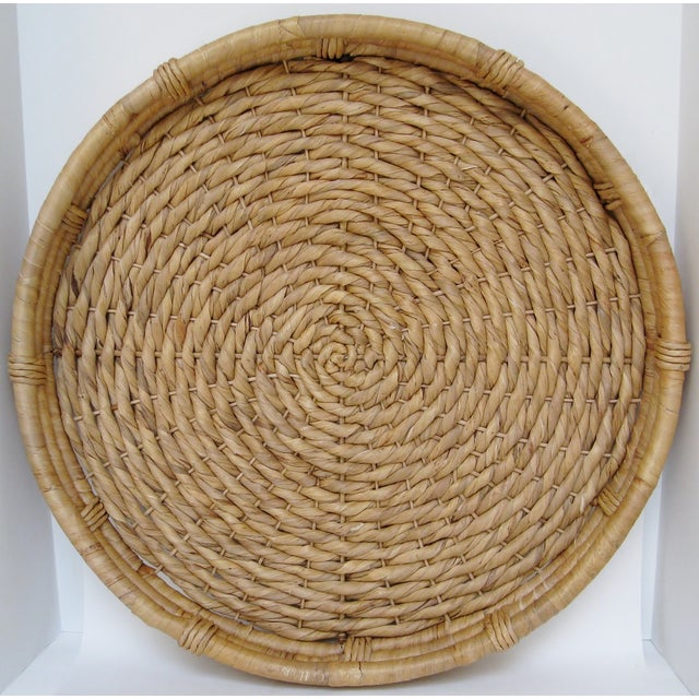 Extra large handmade woven grass fiber shallow basket for the wall. There are metal and fabric hanging hooks on reverse....