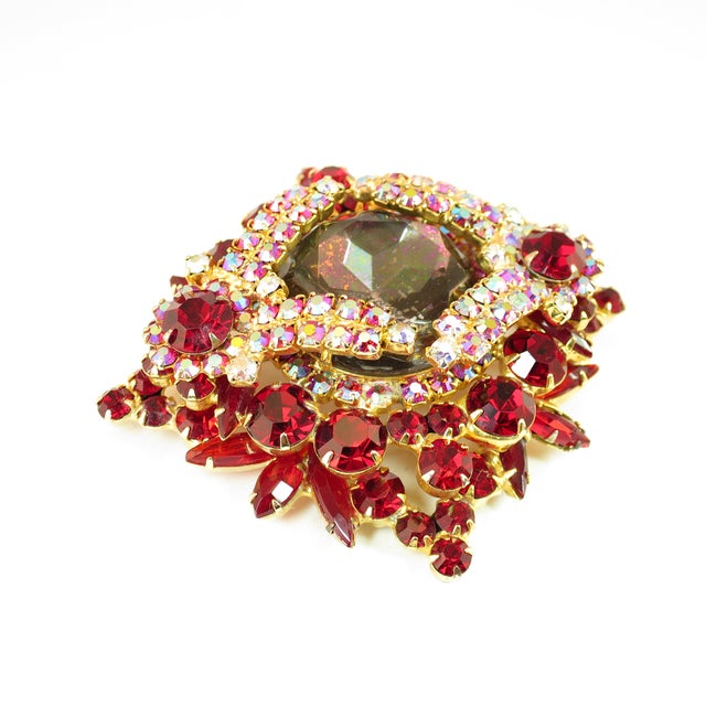 Offered here is a DeLizza & Elster Juliana massive gold-plated brooch from the 1960s. A tiered three-dimensional design is...