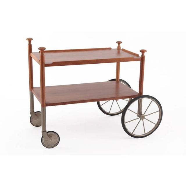 Unusual walnut and nickel bar cart by Wilhelm Renz, circa late 1960s. This all original example has lovely circular...
