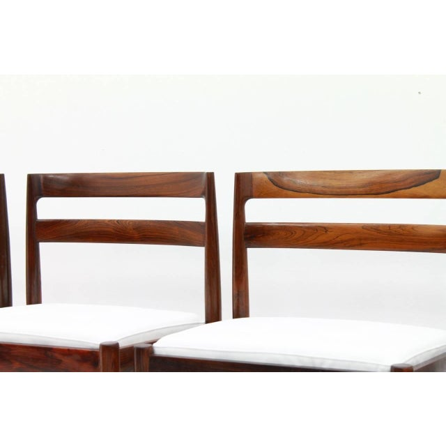 """Set of four dining chairs """"Universe 301"""" by Kai Kristiansen for Magnus Olesen 1965. Very good condition with four new..."""