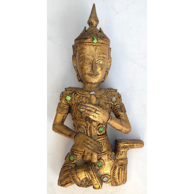 Set of 3 gilt wood carved Thai musician wall hangings. All hand carved and embellished with tiny mirrors. Each playing a...