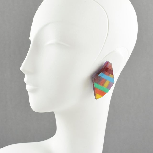 Colorful oversized Lucite clip on earrings designed by Harriet Bauknight for Kaso. Large asymmetric shape with geometric...