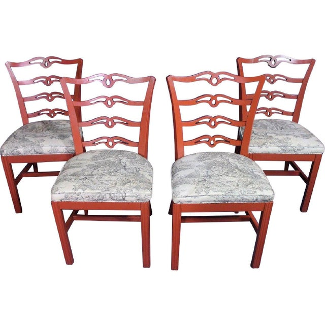 A unique shape lends this rare set of four red-painted, exquisitely carved dining/side chairs a decidedly upscale air, and...