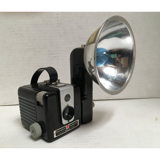 Mid Century Brownie Box-style Kodak camera with flash attachment and blue flashbulb. Great example of collectible obsolete...