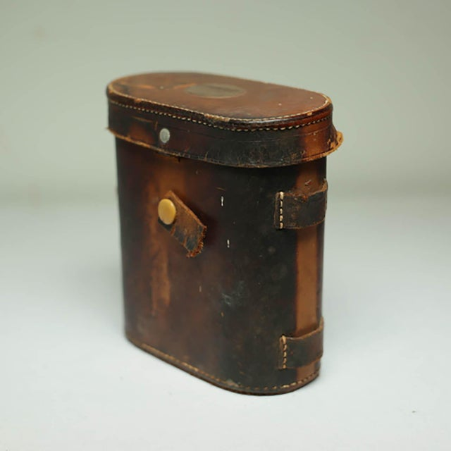 Leather wrapped binoculars in excellent working condition and matching leather case.