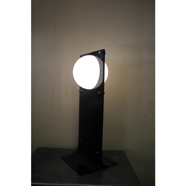 Rare black acrylic lamp by Neal Small. Very seldom do you see the black version of this lamp. With a height of 39.75 this...