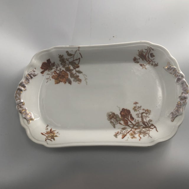 Beautiful holiday serving platter hand painted in France. Made by limoge of France with rich golden hues.