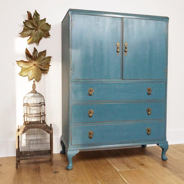 This is truly a one-of-a-kind, vintage gentleman's chest! Painted a bold blue that has undertones of green and gray, the...