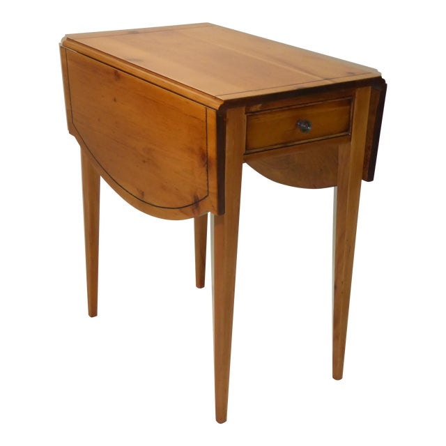 From the 40s, this Pembroke drop-leaf table was made in Maryland by Brandt. Constructed of pine, it features a single...