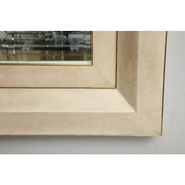 Chic goatskin and shagreen mirror with brass trim.