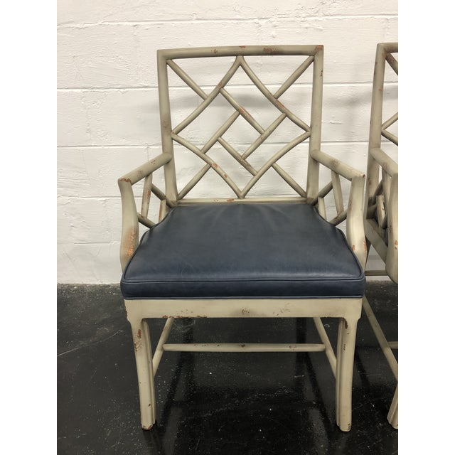 This pair of Fretwork Arm Chairs by Hickory Chair James River Collection would be the perfect pair of head chairs for your...