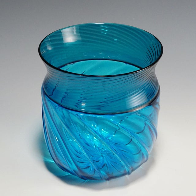 a vase of the opulus series designed by brigitta carlsson and ove thorssen for venini 1972. ribbed blue glass fused in...