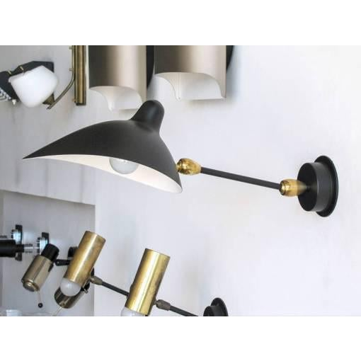 Stunning wall light by Serge Mouille, fully adjustable due to two ball joints on either end of a straight arm, with...