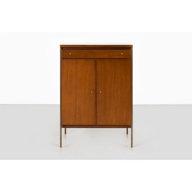 """Connoisseur Collection walnut cabinet designed by Paul McCobb for H. Sacks + Sons USA, c 1950s walnut + brass 34"""" h x 24""""..."""