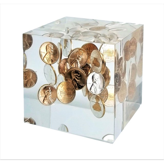 Offering an amazing vintage Lucite sculpture consisting of lots of shiny 1968s pennies floating throughout the entire...