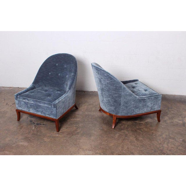 A pair of model 2043 lounge chairs designed by T.H. Robsjohn-Gibbings for Widdicomb. Fully restored with walnut bases and...