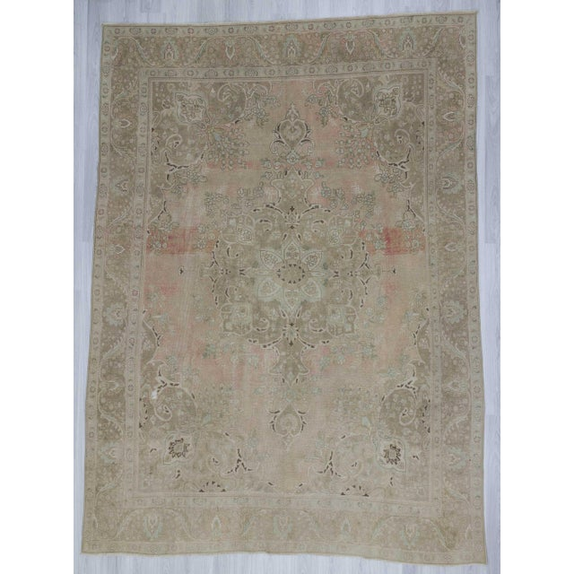 Handknotted vintage Persian rug. In good condition.