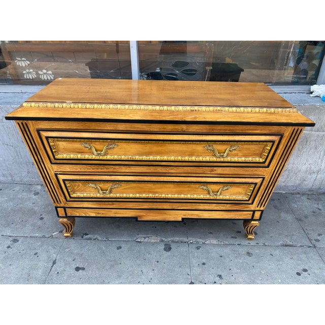 Beautiful Hollywood regency style commode with Two drawers and brass drawer pulls. This dresser Was salvaged out of the...