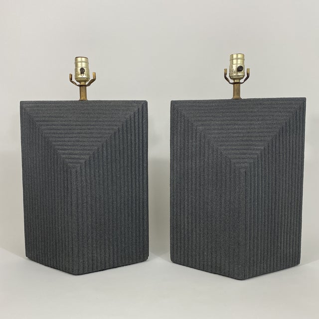 Grey textured ceramic pair of postmodern lamps with a stepped detail that adds great dimension and design aesthetic....