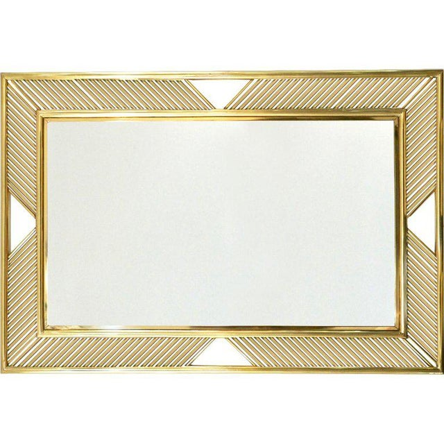 Airy minimal design mirror, entirely handcrafted in Italy, with a contemporary modern double brass frame, adorned with...