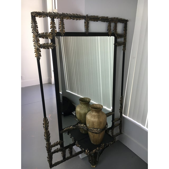 Black Wrought Iron with Gold Leaf Motif Mirror. The Vase has Minor paint chip, shown in pictures.
