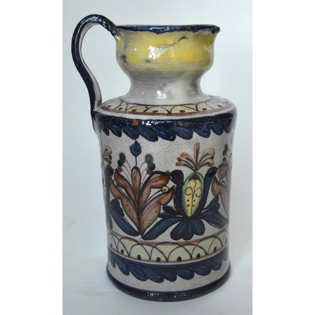A beautiful Mexican majolica pottery pitcher by Capelo of Guanajuato. Javier de Jesus Hernandez, also known as Capelo, a...