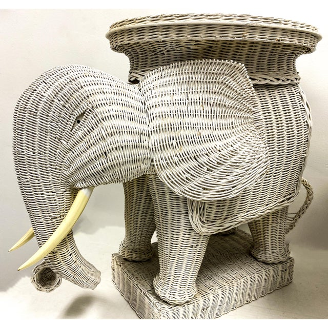 This is a wonderful pair of large scale wicker elephant side table with removable trays. Their detail and size make them...