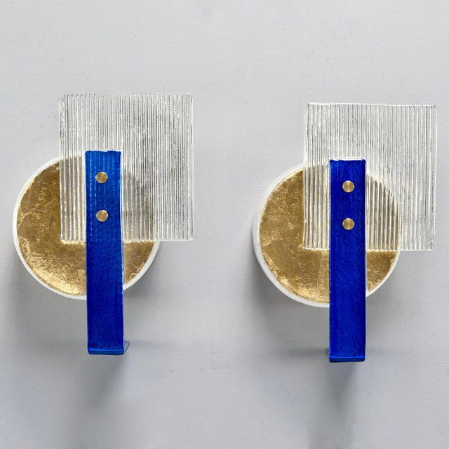 Pair of wall sconces made of vintage Murano glass elements, circa 2010. Clear ribbed glass squares with royal blue glass...