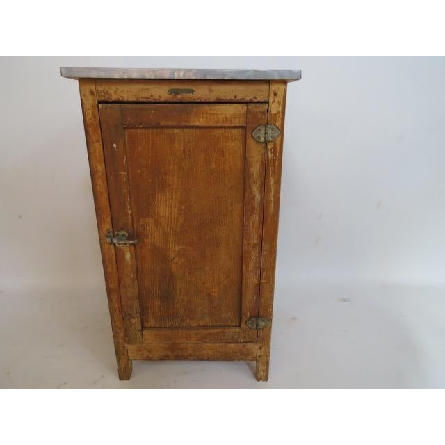 This is an amazing French piece! This 1920s oak ice box has a a zinc top. It is great vintage condition.