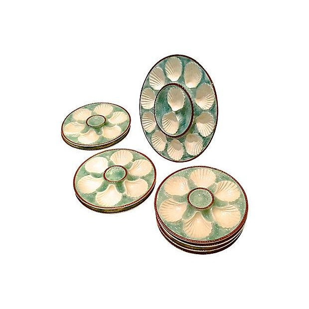 Antique; 1900-1910, French, Majolica, oyster platter and eight plates. Each features shell-shaped depressions to hold the...