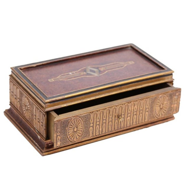 Offered is an ornate Italian gold-washed wood jewelry box with classical carving and painted detail. Some minor paint loss.