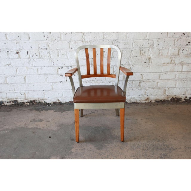 Offering a very nice vintage maple and aluminum chair by Shaw Walker. This chair uniquely has an aluminum frame with with...