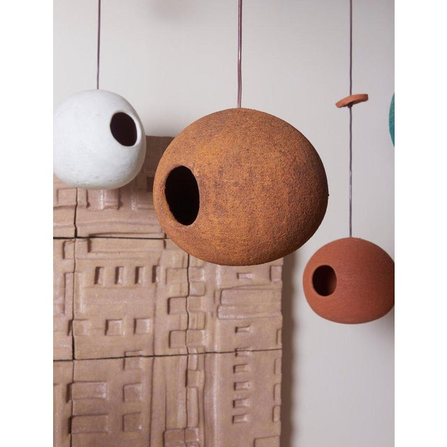 Excellent handmade bird houses of porous lowlfier clay in spray metal by Stan Bitters. The birdhouses are available in...