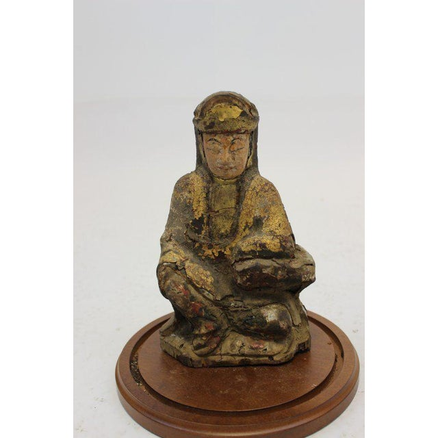 For your consideration is a Rare Vintage Buddha like wooden sculpture with remnants of black red and gold polychrome still...