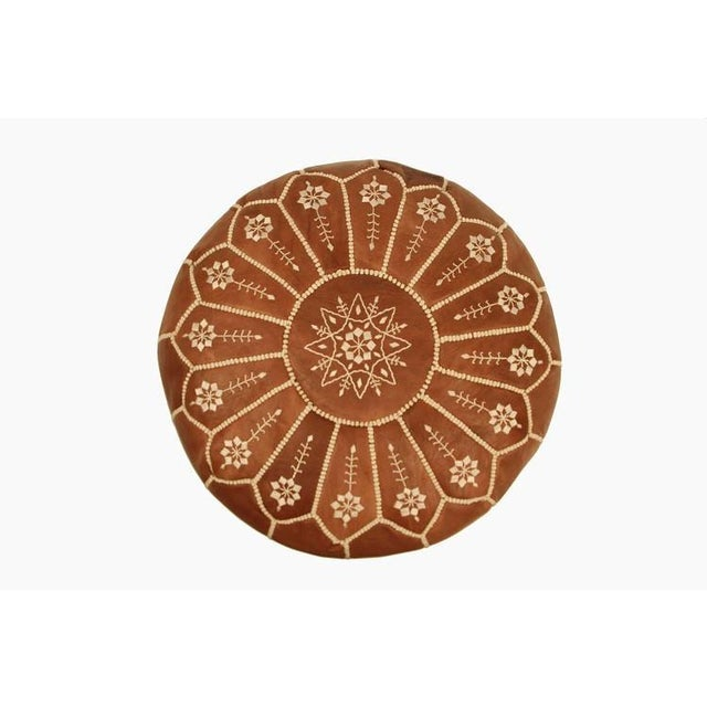 Authentic Moroccan hand-made leather hassock commonly known as Poof is made out of genuine soft leather and has an...