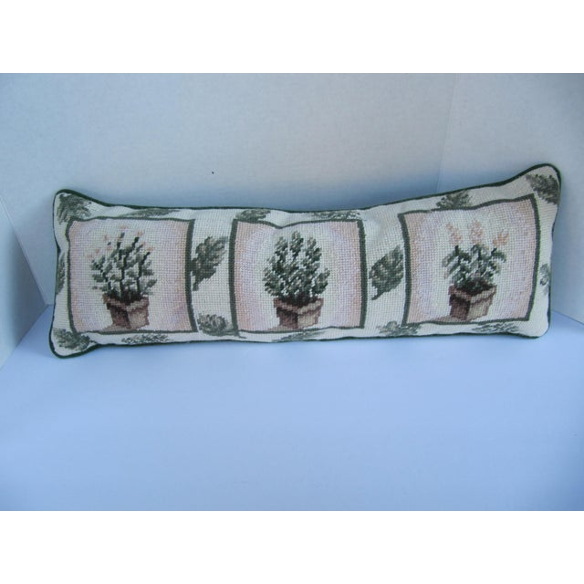 Beautiful needlepoint pillow with three squares depicting trees in containers. Back is velvet.