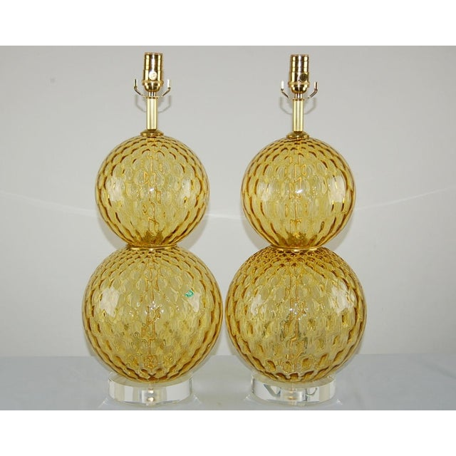 Vintage Venetian stacked ball glass table lamps of HARVEST GOLD, with brass wafers at the waist. Great texture to the...