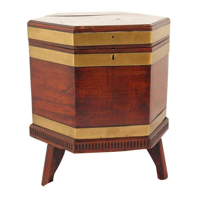 Chippendale mahogany cellaret with bold brass banding.