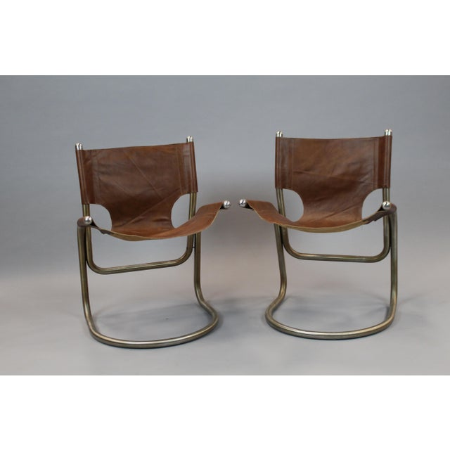 """Pair of Italian mid-century chairs with new leather and aluminum bases. Seat Height: 18"""" *Please remember: The majority of..."""