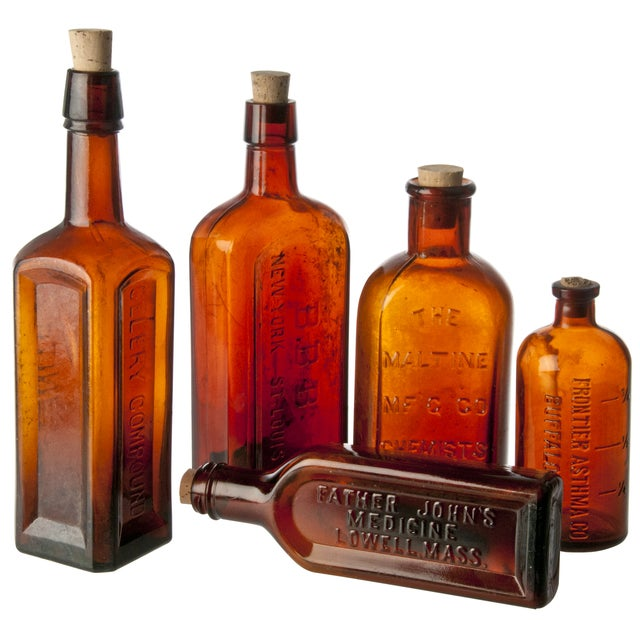Collection of five, vintage amber glass bottles. These bottles are perfect for display on a shelf or in a windowsill....