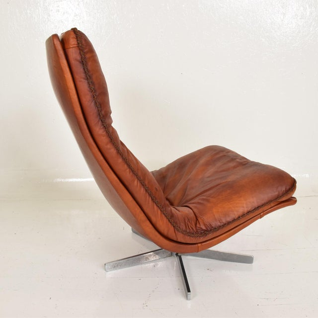 For your consideration, a Mid Century Modern Pair of James Bond Arm Chairs by De Sede, Model S 231. Beautiful patinated...